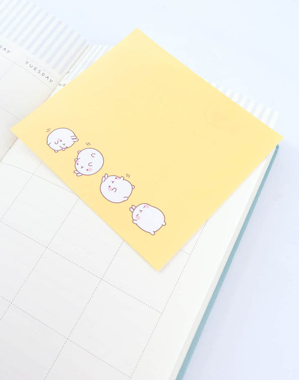 A cute yellow  Molang Happy Mood Square Memo Pad.