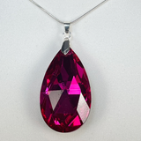 Necklace with ruby teardrop pendant