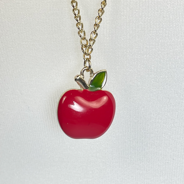 Long necklace with red apple