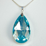 Necklace with blue teardrop pendant