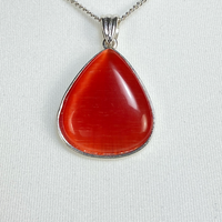 Necklace with red teardrop pendant