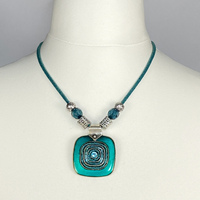 Leather cord necklace with green pendant