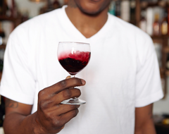 A person holding a glass of wine