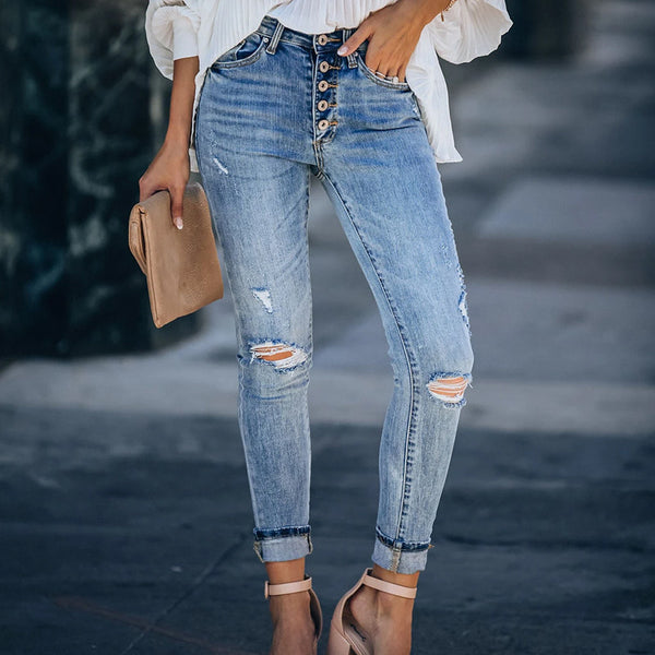 Mid-rise hole jeans