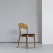 Hans K Rainbow Dining Chair Oak with black leather seat at EDITO