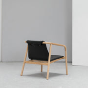 Contemporary Black leather Scandinavian armchair at EDITO Furniture