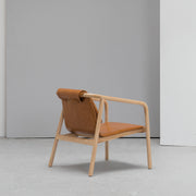 Contemporary tan leather Scandinavian armchair at EDITO Furniture