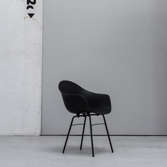 TOOU TA Bucket Armchair black with metal legs at EDITO Furniture