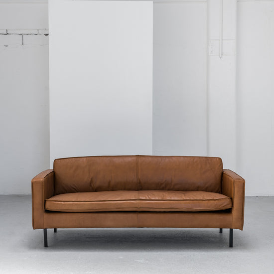 industrial tan leather sofa with black legs at EDITO Furniture