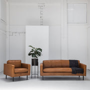 industrial tan leather sofa and armchair with black legs at EDITO Furniture