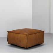 Large contemporary tan leather ottoman with raw edge at EDITO Furniture