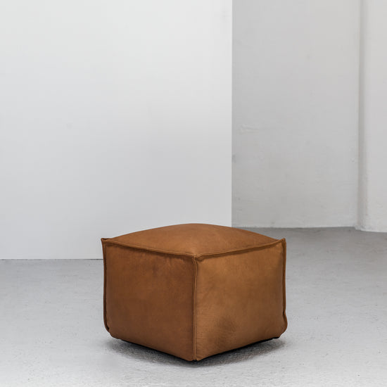 small tan leather Ottoman at EDITO Furniture