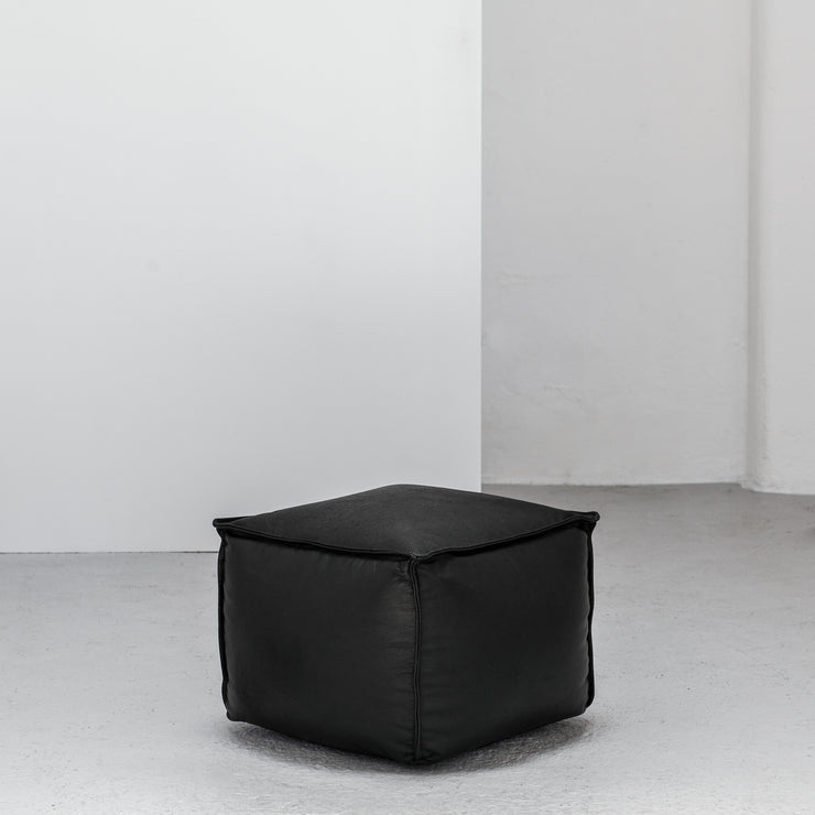 small black leather Ottoman at EDITO Furniture
