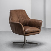 Vintage tan leather Swivel Chair with stitching and metal base at EDITO