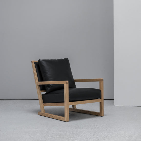 scandinavian Camerich Simon Armchair black leather and oak at EDITO Furniture