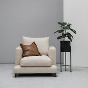 Camerich Lazytime Armchair with tan cushion next to plant at EDITO