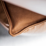 Tan leather stitching detail at EDITO Furniture