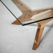 Coffee Table with tempered glass top and architectural modern wood base at EDITO Furniture