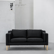 Modern black leather 2 seater sofa with wooden legs at EDITO Furniture