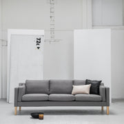 Modern Scandinavian grey 3 seater sofa with wooden legs at EDITO Furniture