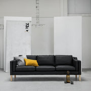 Modern black leather 3 seater sofa with yellow cushion at EDITO Furniture