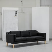 Modern black leather 3 seater sofa with wooden legs at EDITO Furniture