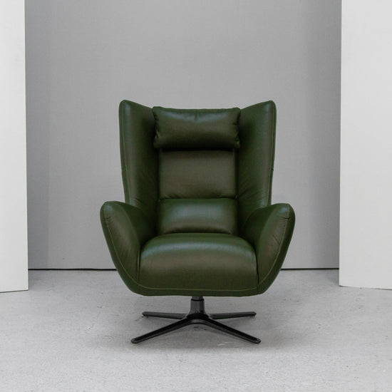 Green leather retro swivel chair at EDITO Furniture