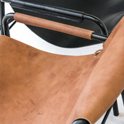 Tan leather slung armchair or occasional chair with black metal frame at EDITO Furniture