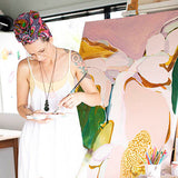 Artist Jen Sievers painting at her studio in the Waitakeres, Auckland, NZ
