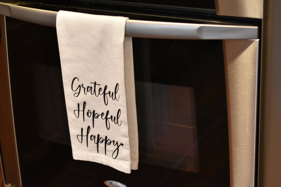 Grateful towel handing from oven handle