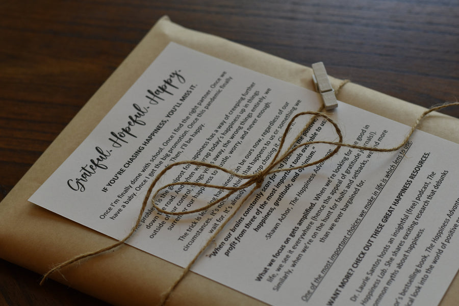 Grateful Hopeful Happy towel gift wrapped with kraft paper and twine