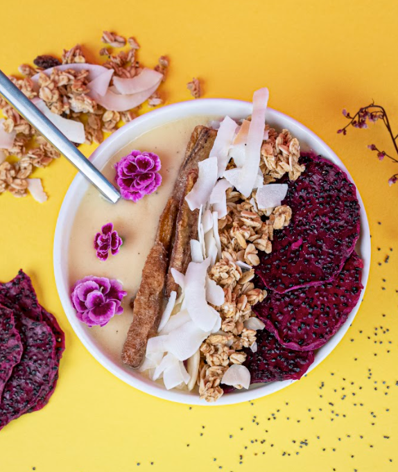 Brightly coloured smoothie bowl with tropical fruits