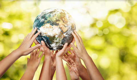 benefits of a sustainable diet: hands holding model of the world
