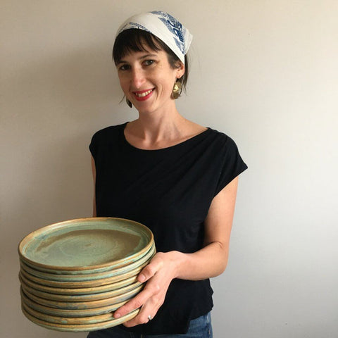 Laura with dinnerware