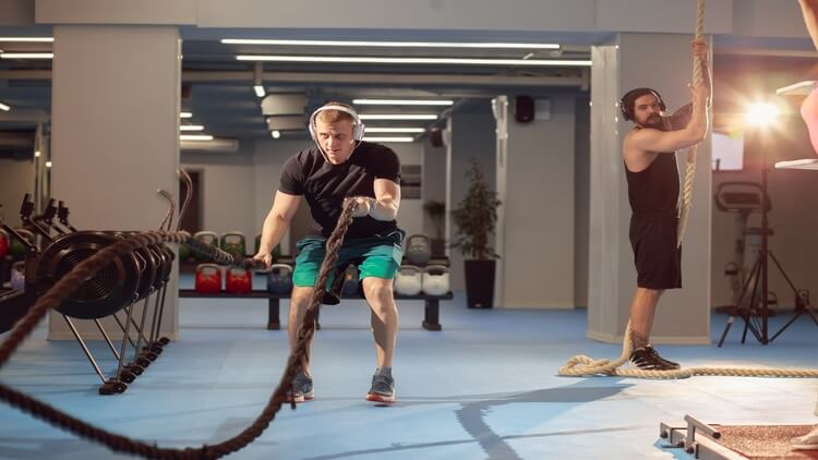 Crossfitter with ropes
