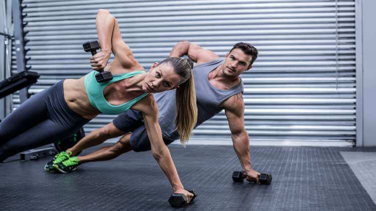 Couple doind the side plank
