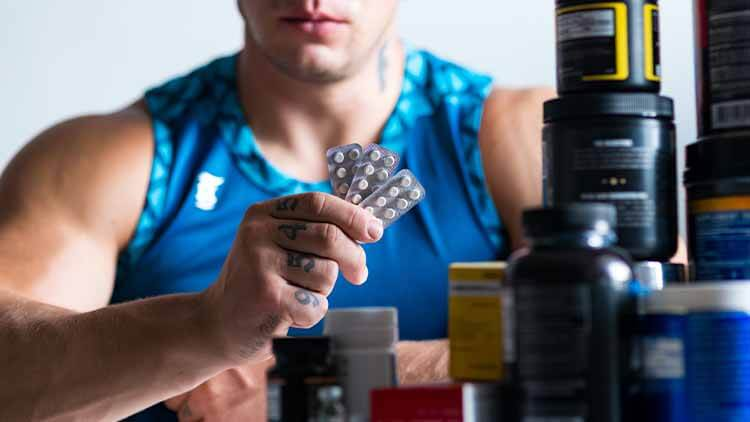 Close up of drugs in hands of a professional bodybuilder