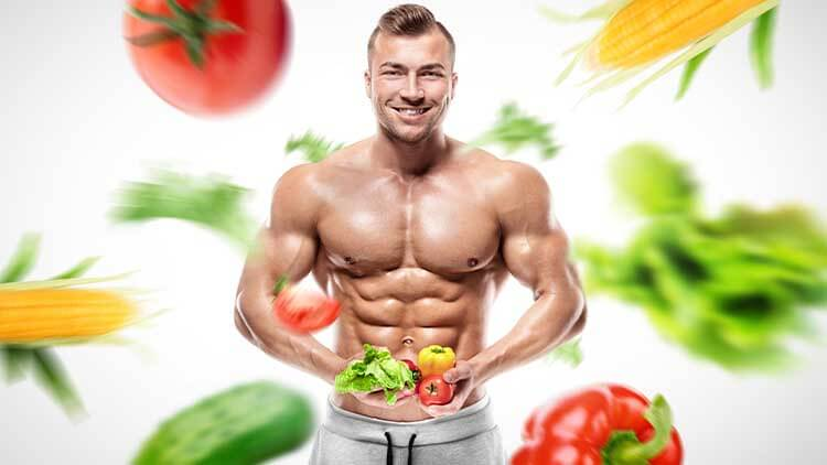 Shaped and healthy bodybuilder holding a fresh vegetables