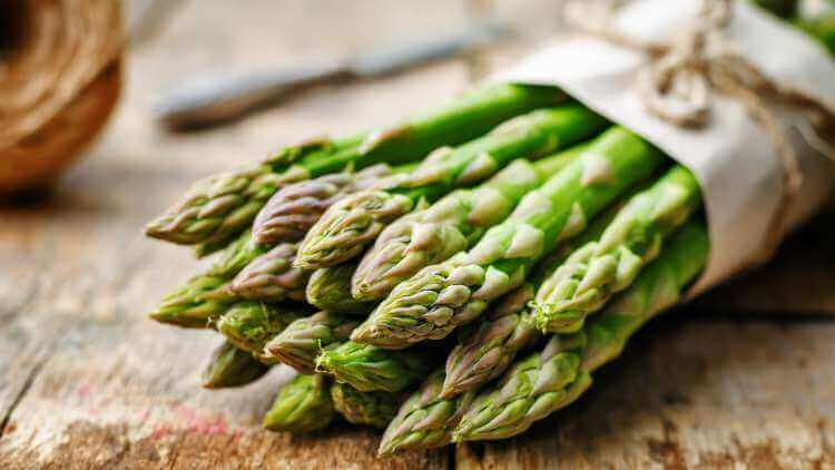 Asparagus bunch on wooden table