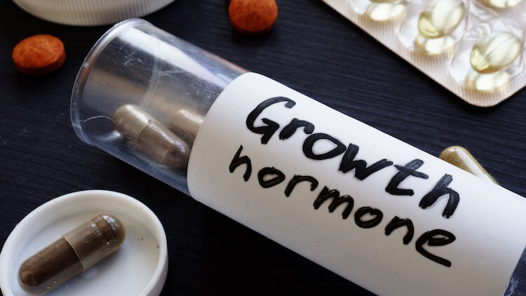 human growth hormone pills in a container