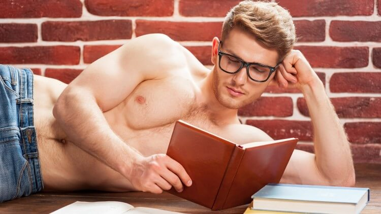Man laying down resting head on arm reading books