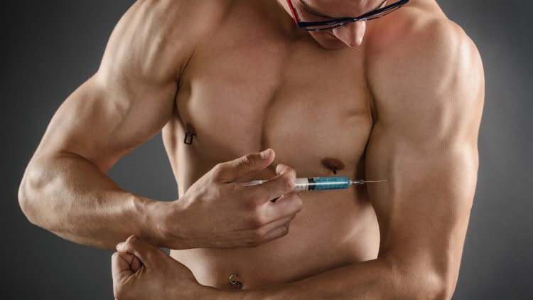 Man looking down injecting into arm