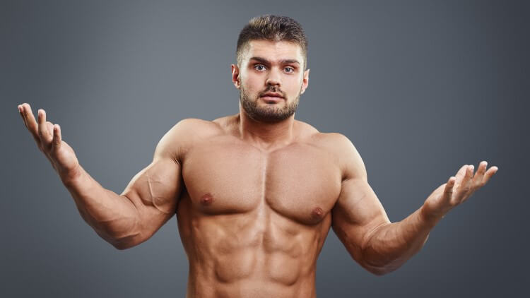Muscular shirtless young man looking confuse