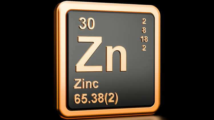 periodic table symbol for Zinc on a black background