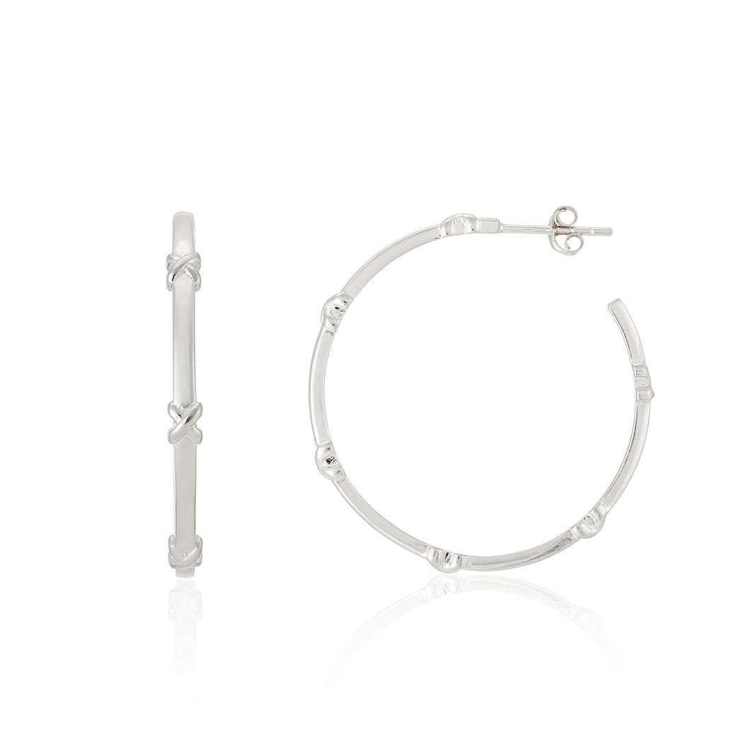 Deia Kiss Hoop Earrings