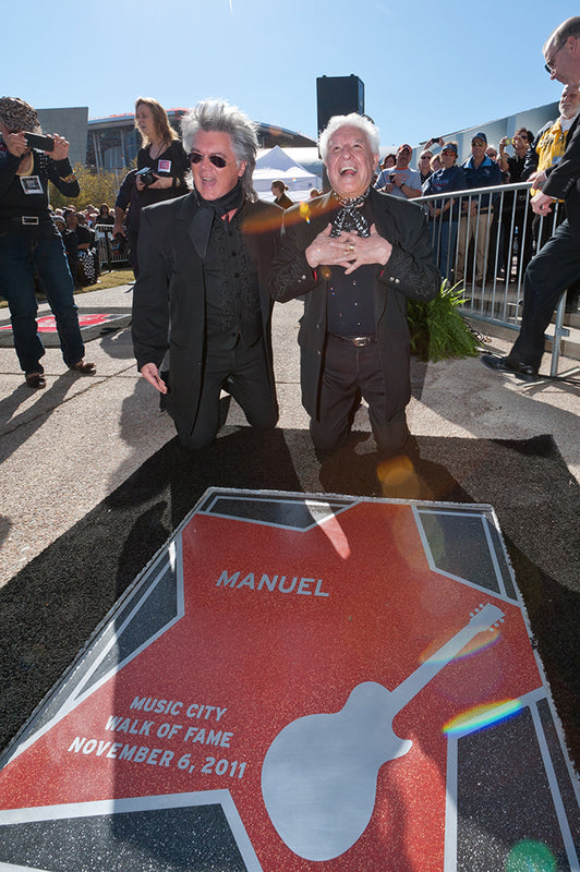 Inducts Manuel into the Music City Walk of Fame
