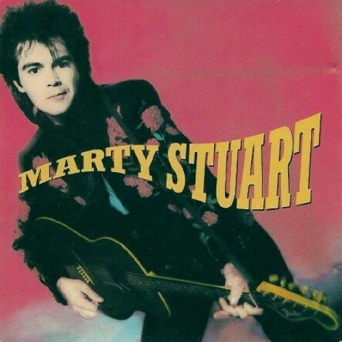 Major label debut with Marty Stuart on Columbia Records