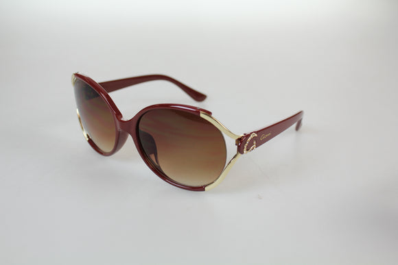 Gionni Sunglasses - Large Round Plastic With G Side Arm Logo Sunglasses in Brown