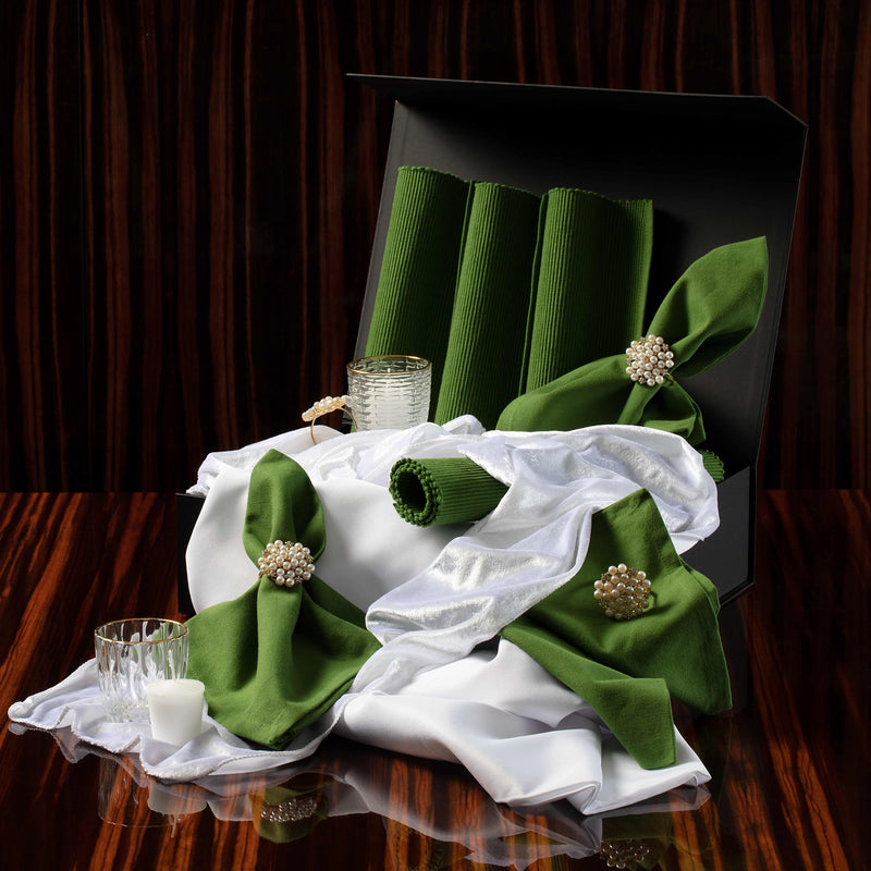 Evergreen Tablescape  Kit items including green placemats and napkins, pearl napkin rings, candles and tablecloth.