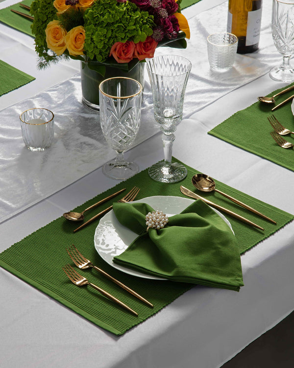 Angie's Tables Evergreen Tablescape single setting with green placemat and napkins, pearl napkin ring.